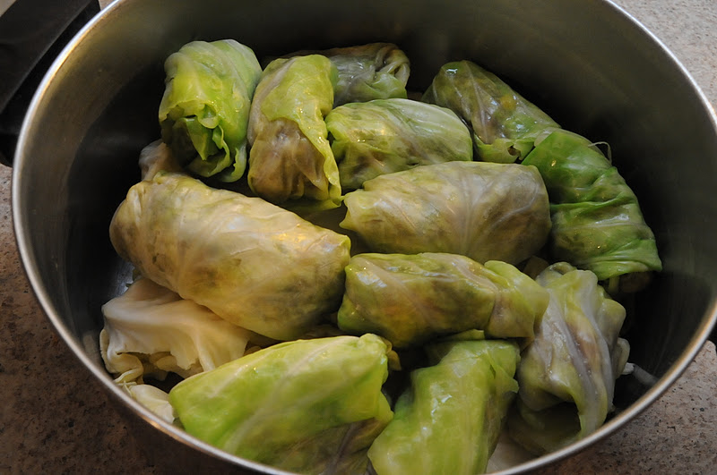 These dolma are resting on top of discarded cabbage leaves.