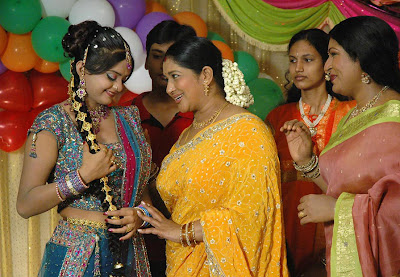 Actress Kavitha in Yellow Saree Photos