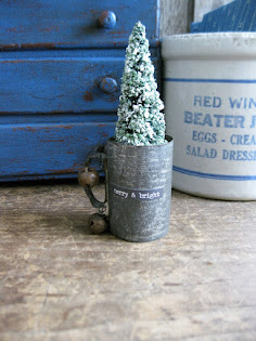 tiny tree in a tin cup