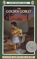 cover of The Golden Goblet by Eloise Jarvis McGraw shows an Egyptian boy looking over his shoulder while finding a goblet in a trunk