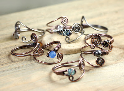 copper and silver wire rings in fantasy style