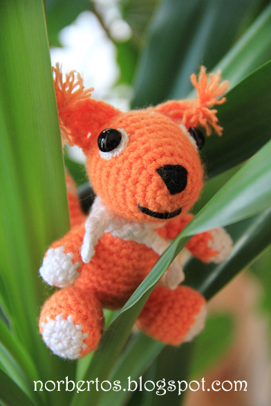 Crochet squirrel on a tree