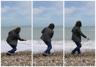 beach sea seafront throwing stones