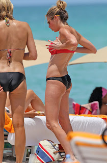 ERIN ANDREWS showing her new boobs to friends at a beach