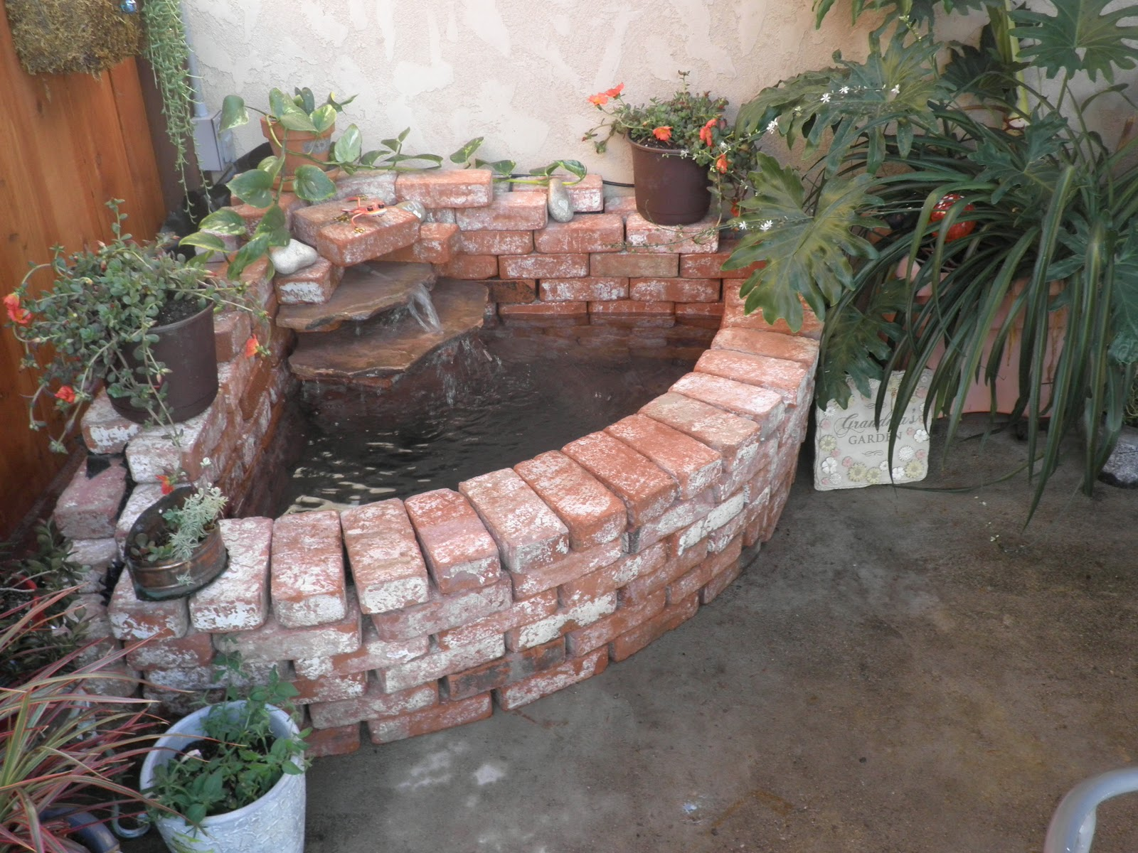 Stringbeadz designs how to build your own brick waterfall for Waterfall features for ponds