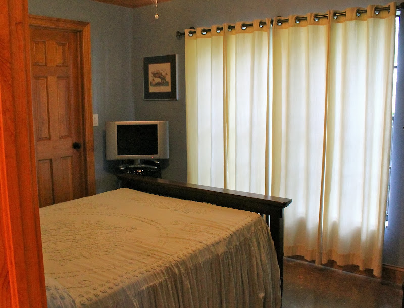BEDROOM #2: 10' X 11 ½' W/POLISHED, STAINED CONCRETE FLOOR  title=