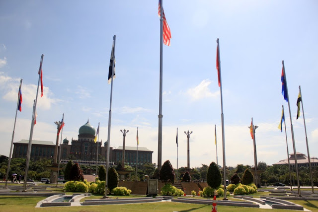 The large square with flagpoles of the Malaysian flag and 13 states'  flags in front of Masjid Putra or Putra Mosque in Putrajaya, Malaysia