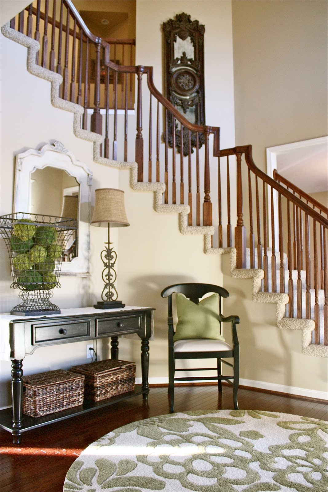 The yellow cape cod client project foyer before and after for Foyer staircase decorating ideas