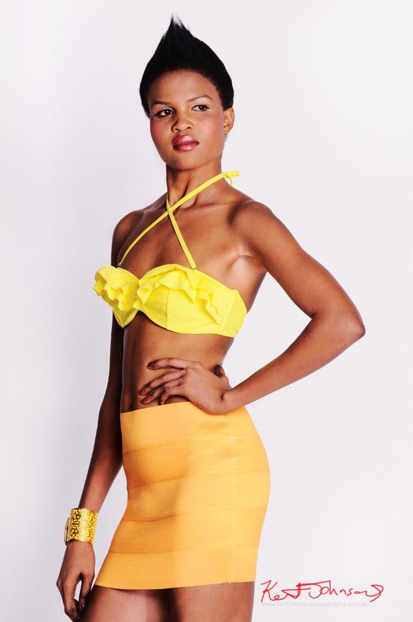 Bikini top and orange skirt, mid shot for modelling portfolio.