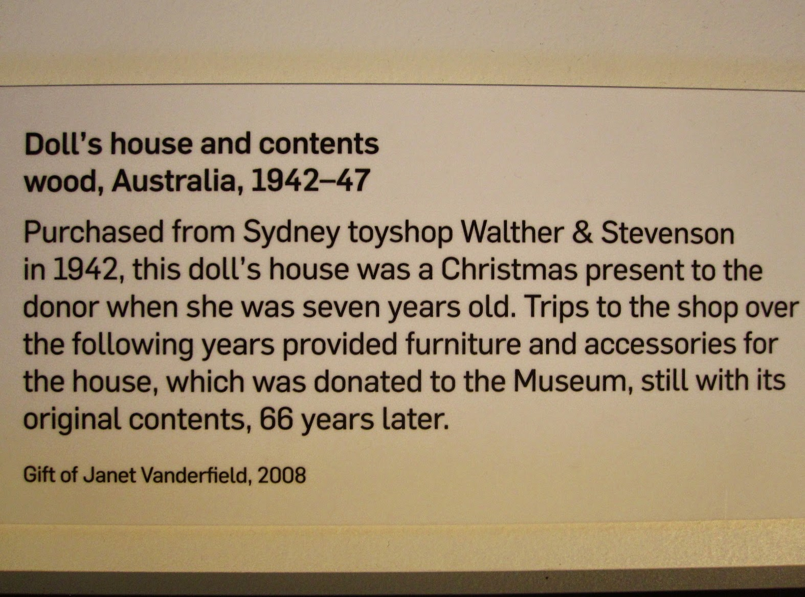 Museum sign for 'Doll's house and contents wood, 1942-47'