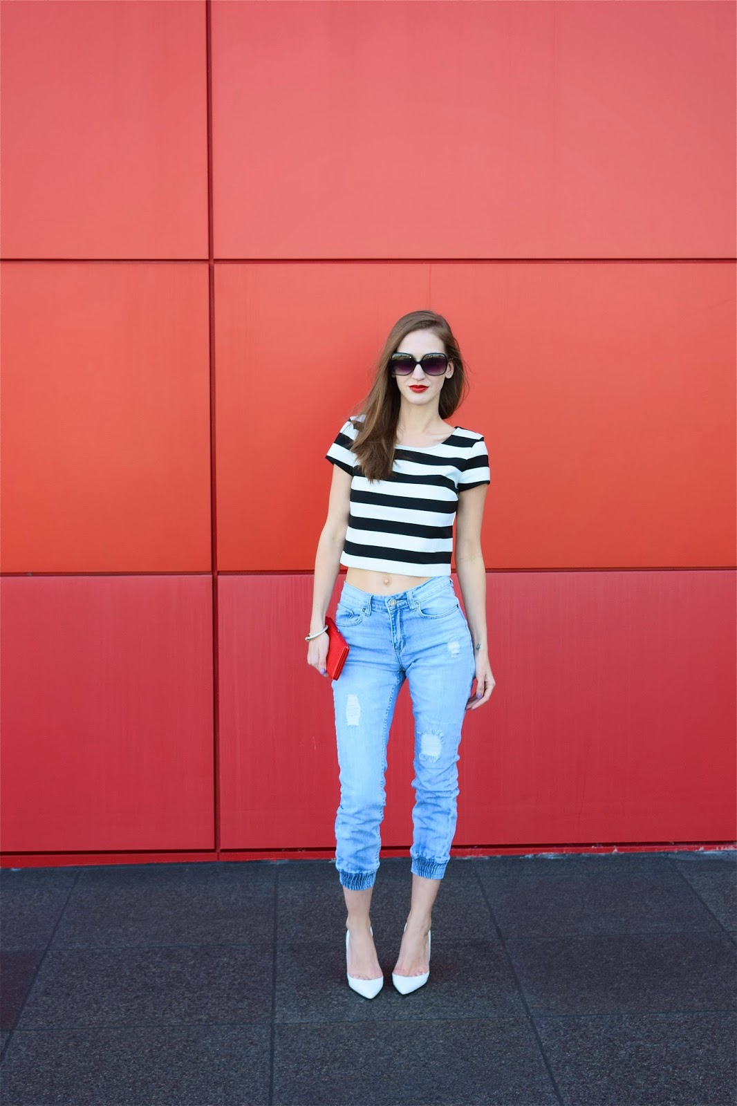 Wearing black and white striped crop top, Denim Joggers, White kid leather Christian Louboutin half d'Orsay pumps
