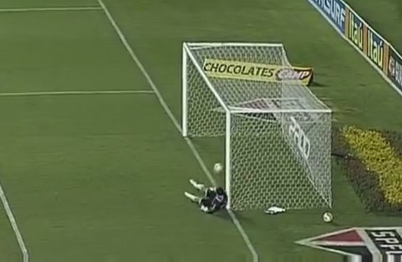 São Paulo goalkeeper Rogério Ceni watches in horror as he fumbles the ball into his own net