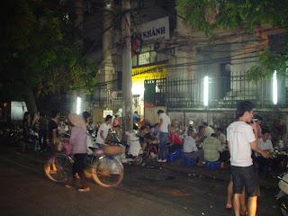 Vietnamese sitting on low stools plastic (Vietnam)