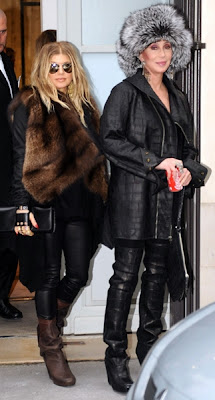 Cher and Fergie in similar outfits