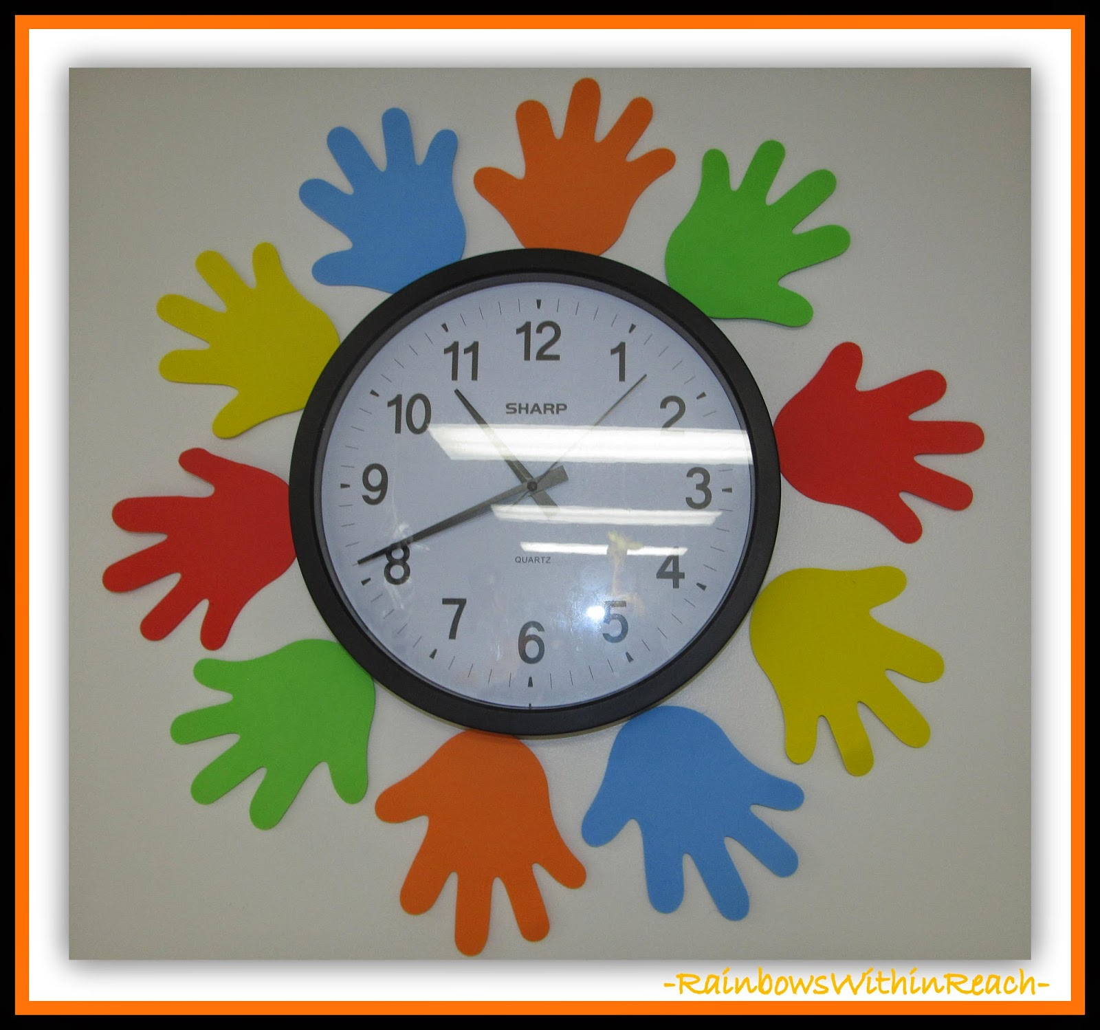 Classroom Clock Adorned with Hands {Hand RoundUP at RainbowsWithinReach}