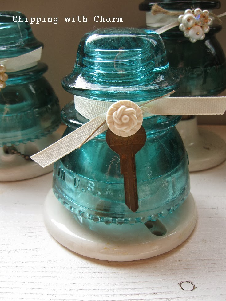 Chipping with charm aqua glass insulator trees more for Glass insulator ideas