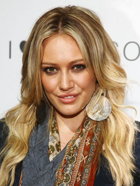 Hilary Duff's long, center-parted layers are smooth on top and gradually phase into large waves