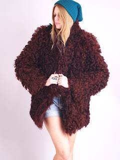 Vintage 1970's fluffy wine colored mongolian fur coat made in France.