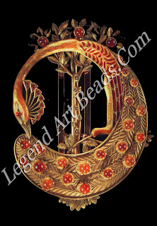 """A """"peacock"""" belt buckle design of 1900 by Coasset of gold enamel and cabochon cornelians."""