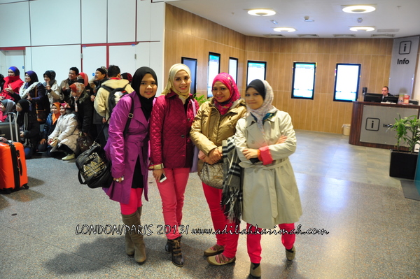Adibah Karimah at airport going to London for free