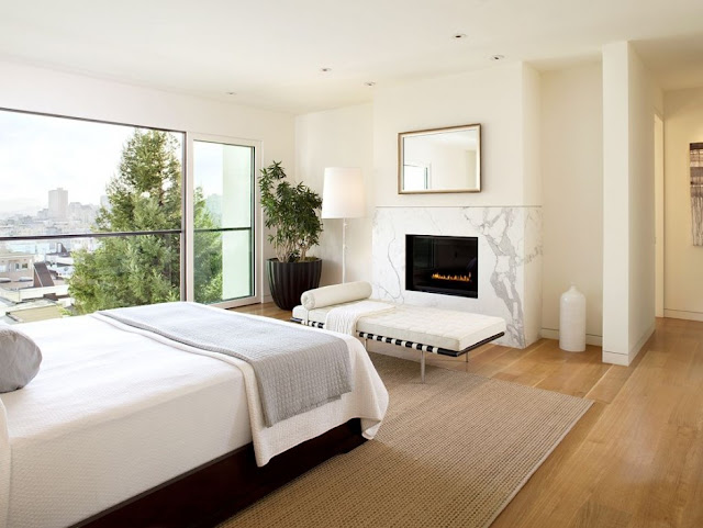 Bright white bedroom with a view