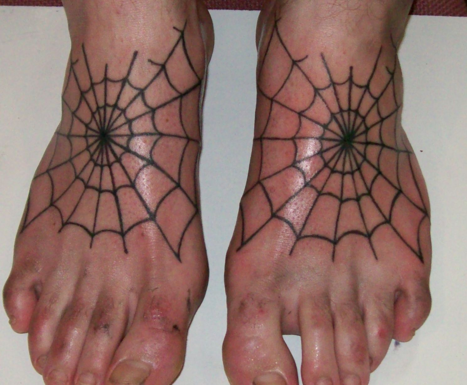 Displaying 13 gt images for feet tattoos for men