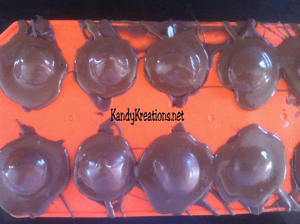 Celebrate Halloween with this sweet Pumpkin candy recipe.  These chocolate covered cherries are in the shape of pumpkins using a cheap dollar store mold and an easy candy recipe.  These chocolate candies are perfect for any fall holiday including Halloween and Thanksgiving, or just a more beautiful take on the store bought chocolate covered cherries.