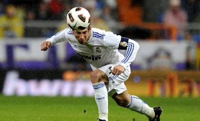 Sergio Ramos as captain of Real Madrid heading a ball