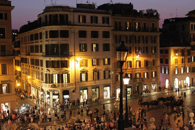Spanish Steps is getting crowded with the locals and tourists at night in Rome, Italy