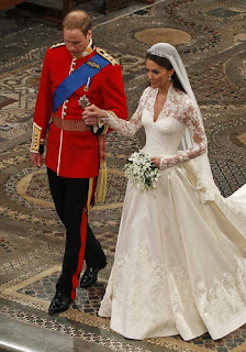 The newlyweds Prince William and Kate Middleton walk up the aisle after their wedding ceremony.