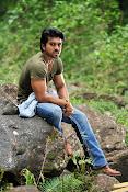 Ram Charan Rocking Photos from Racha Telugu Movie-thumbnail-4