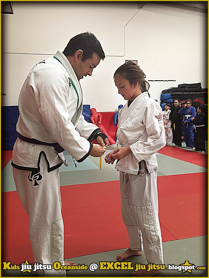 BJJ Kids earning Brazilian Jiu Jitsu promotions at Excel Oceanside Jiu Jitsu