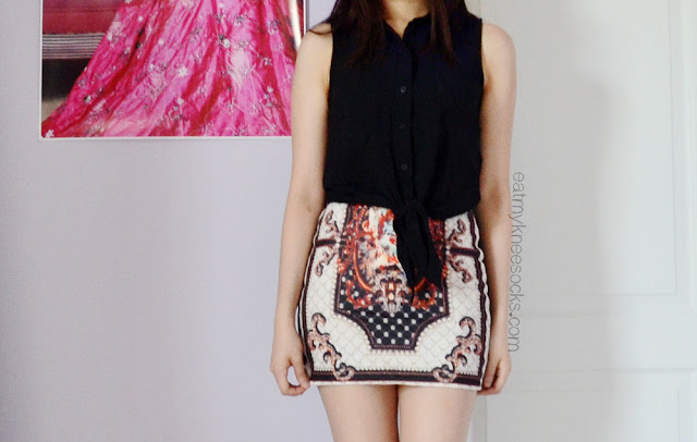 Pair intricately-patterned skirts, like Dresslink's baroque skirt, with simple tops like this Forever 21 tie-front blouse.