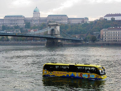 Boat shaped like a bus in a city river
