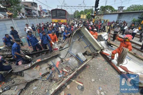 Photos: Commuter train slams into passenger bus, killing 14 and injuring 10 in Indonesia