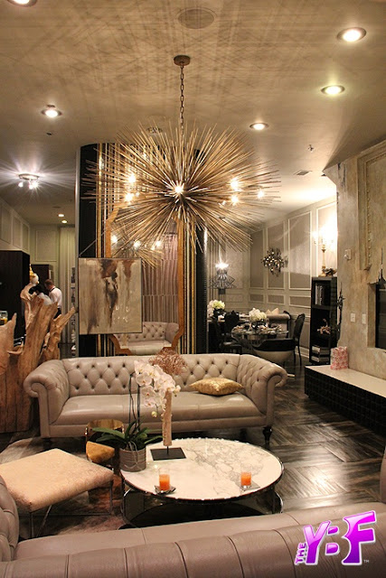 dark wood floors beige furniture gold sputnik chandelier old hollywood glamorous style