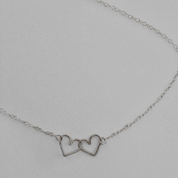 http://www.shopstyle.com/browse?pid=uid6496-22988364-91&fts=double+heart+necklace