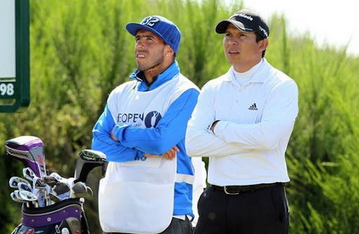Carlos Tévez looks on with Andrés Romero during the 2012 British Open Golf Championship