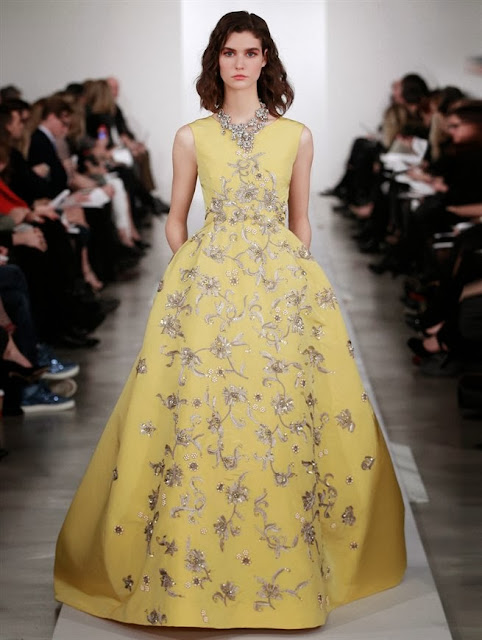 Model wearing a yellow ball gown in Oscar de la Renta's 2013 Pre Fall runway show