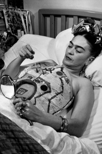 Frida Kahlo painting on her corset in hospital bed