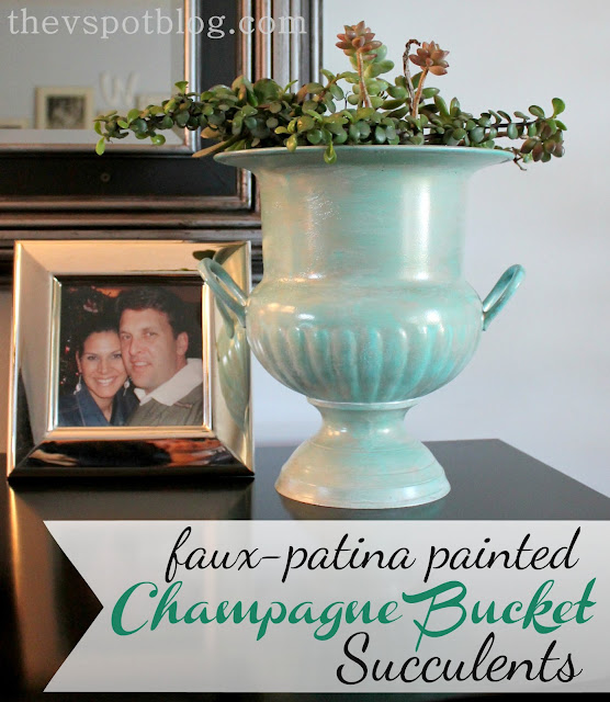 champagne bucket, copper patina, succulents, silver, silver frame, black dresser, planter