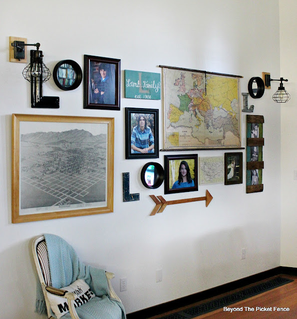 vintage maps, gallery wall, sconces, arrow, family sign, http://bec4-beyondthepicketfence.blogspot.com/2015/10/gallery-wall-with-awesome-light-sconces.html