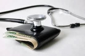 picture of stethoscope with a cash-stuffed wallet