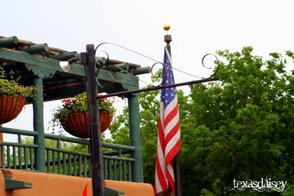 American Flag flies near New Mexico Style Porch Taos New Mexico