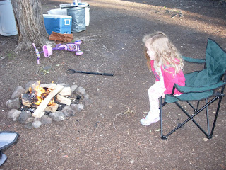 toddler watching the campfire