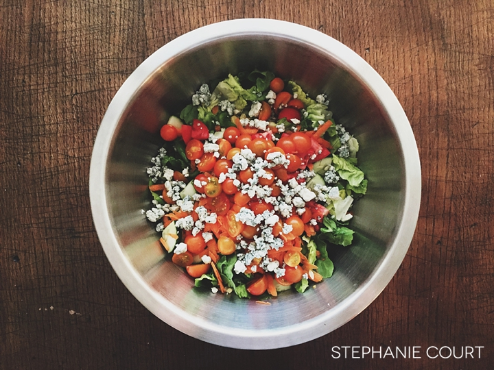 summer salad with tomatoes cucumbers basil blue cheese