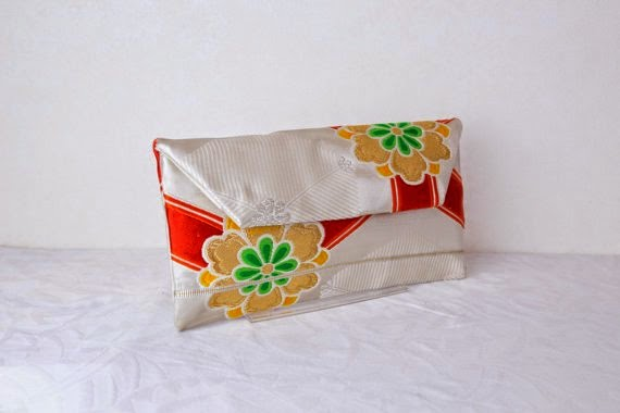 https://www.etsy.com/listing/212496404/wedding-clutch-bag-golden-blossoms?ref=favs_view_2