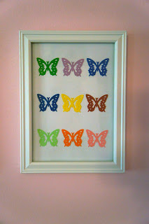Small frame from Target and 3M command strip to attach butterfly punch art to nursery wall | A Crafty Wife