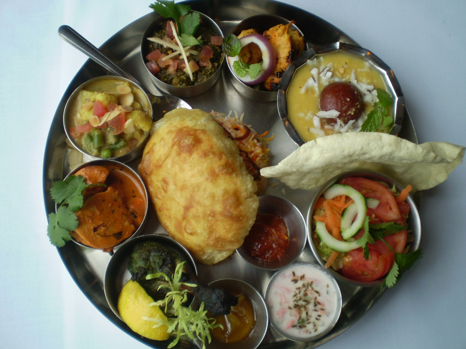 Food india cook eating at indian thali and a mashed eggplant recipe non veg thalis include meat and seafood the dinner menu adds thai dishes influenced by both india and china forumfinder Image collections