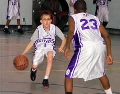 Kid dribbling basketball